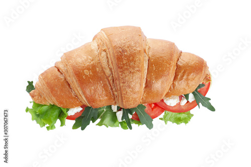 Fotografie, Obraz  Tasty croissant sandwich with feta cheese and tomato isolated on white, top view