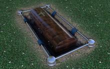 Modern Coffin Into Grave
