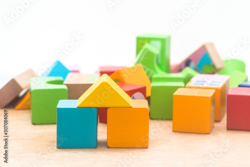 Tela Wooden blocks built on wooden boards and faded brick backgrounds