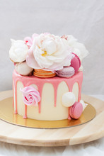 White Cake With Pink Melted Ch...