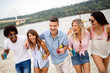 Group of friends having fun on the beach. Summer holidays, vacation and people concept.