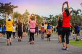 group People doing aerobic dance after work for exercise at public Park, selective focus