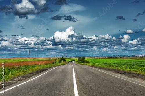 Obraz speed highway through the field. asphalt-paved road - fototapety do salonu