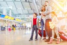 Family On Vacation At The Airport Or Train Station