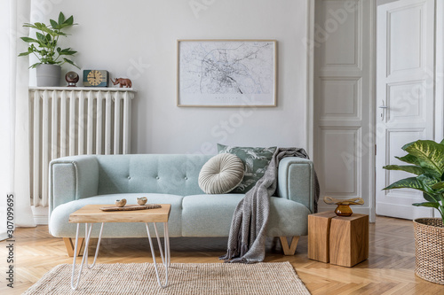 Fototapeta Modern scandinavian living room interior with stylish mint sofa, furnitures, mock up poster map, plants, and elegant personal accessories. Home decor. Interior design. Template. Ready to use.  obraz na płótnie