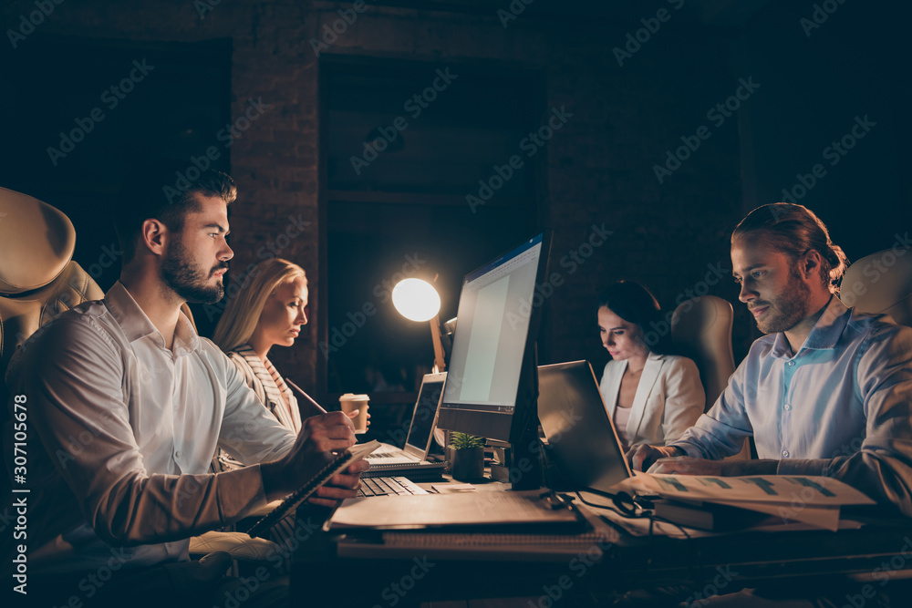 Fototapeta Profile side view of four people sitting in front of screen writing code solving tech issue supporting clients analyzing IT documents task deadline at late night work place station