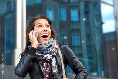 Emotional business woman talking on the phone Canvas Print