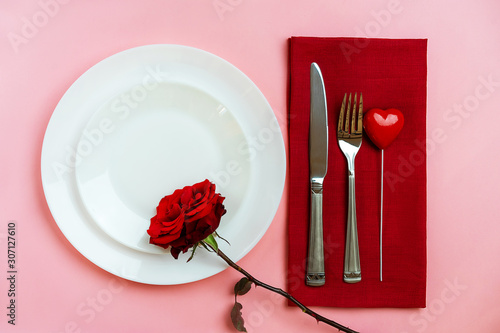 Romantic table setting for Valentines day or dinner date celebration wedding.