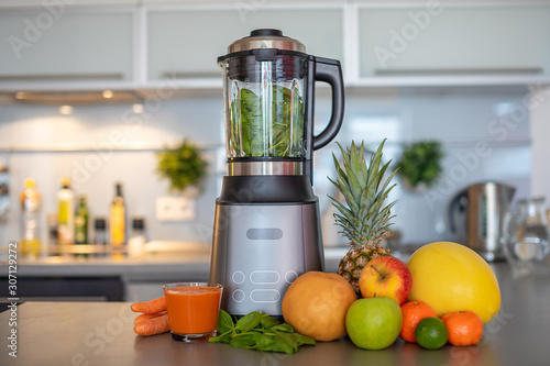 Making green smoothies with blender in home kitchen, healthy eating lifestyle co Canvas Print