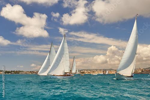 Leinwand Poster Yachting sport. Sailing yacht under full sail at the regatta