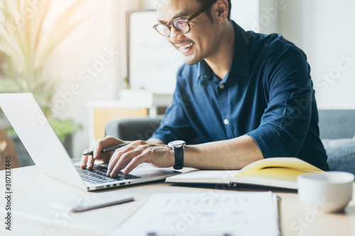 hand holding using texting cell phone and typing computer.businessman at workplace Thinking investment plan.chatting contact Investor.searching for information use internet.connecting people concept - 307137440