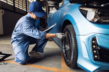 Maintenance Male Checking Tire Service Via Insurance System At Garage, Safety Vehicle To Reduce Accidents Before A Long Travel, Blue Car Of Man Transportation Lifestyle