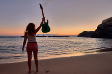 Girl With Electric Guitar On The Beach In Tenerife, Canary Islands, Spain