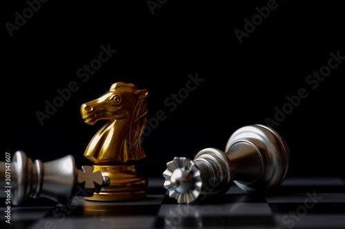 Golden knight stand as last winner over silver king on chess board Wallpaper Mural