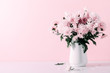 canvas print picture - Fresh bouquet of pink flowers in vase on white shelf on pink wall background. Floral home decor.
