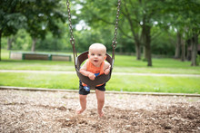 Baby On Swing In Park
