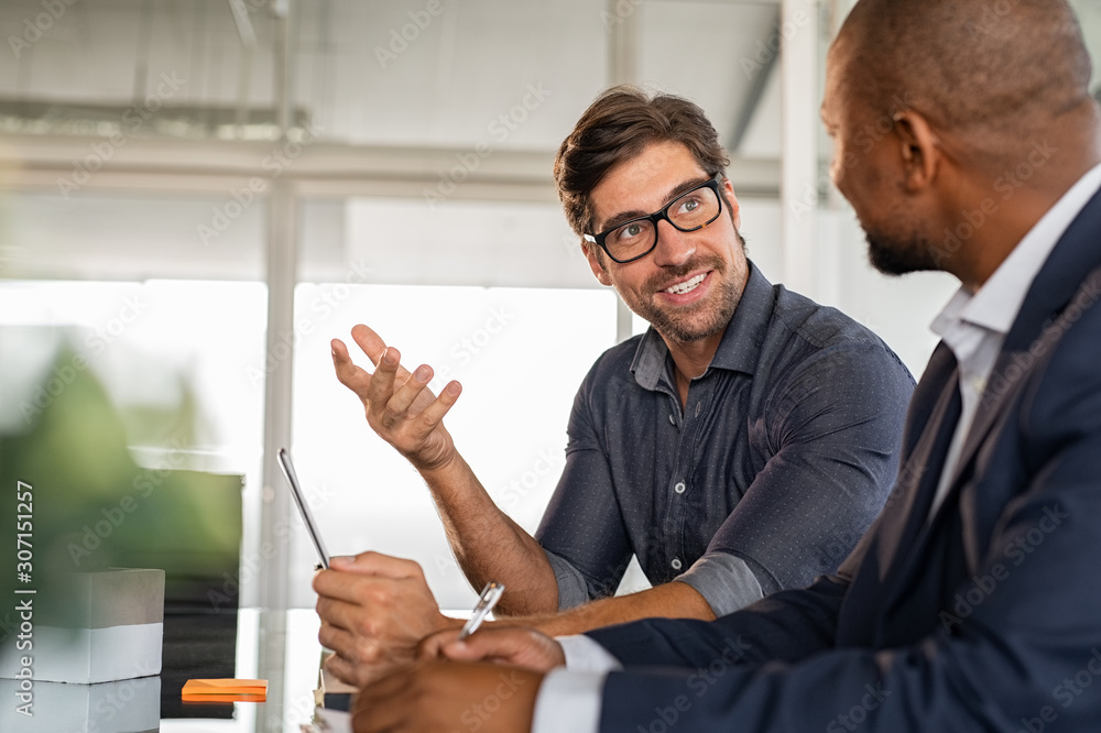Fototapeta Businessman discussing project with colleague