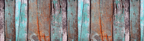 Painted wooden texture. Old wooden boards with a knots close-up. Empty background. Panoramic banner.
