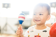 Little Asian Toddler Boy Play Colorful Maracas And Sing A Song In Class Room.Pre Kindergarten Boy Play Music.Child Development EQ And EF.Child With Music Instruments.Musical Education.