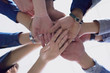College Students Teamwork Stacking Hand Concept. Close up of young people putting their hands together. Friends with stack of hands showing unity and teamwork.