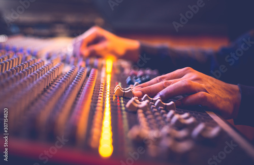 Canvas Print male producer, sound engineer hands working on audio mixing console in broadcast