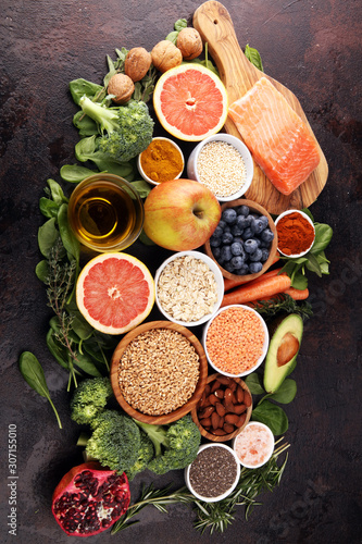 Aluminium Prints Healthy food clean eating selection: fish, fruit, vegetable, cereal, leaf vegetable on rustic background