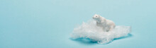 Panoramic Shot Of Toy Polar Bear On Plastic Packet On Blue Background, Environmental Pollution Concept