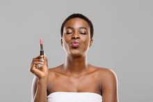 Pretty Afro Woman Holding Pink Lipstick And Sending Air Kiss