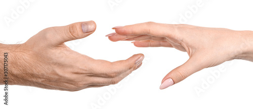 Fotomural  Female and male caucasian hands  isolated white background showing gesture reach for each other with fingers, love