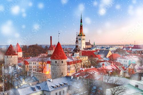 Fairytail Medieval Old Town, St Olaf Baptist Church and Tallinn City Wall in sno Canvas Print