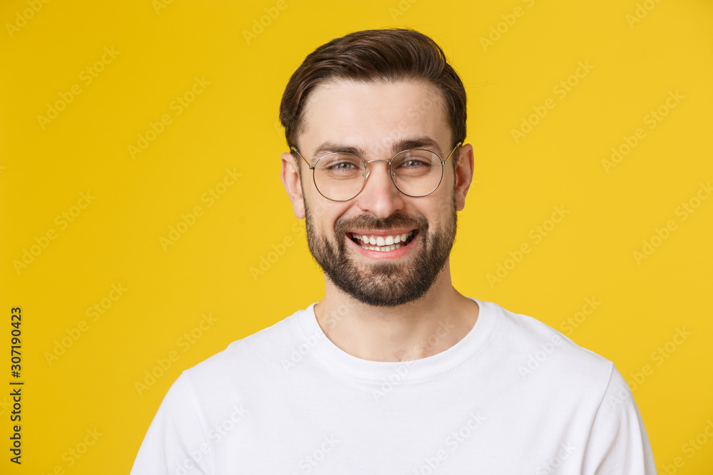 Fototapeta Young casual man portrait isolated on yellow background