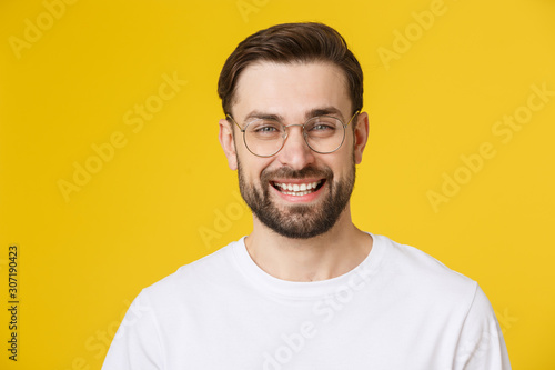 Obraz Young casual man portrait isolated on yellow background - fototapety do salonu
