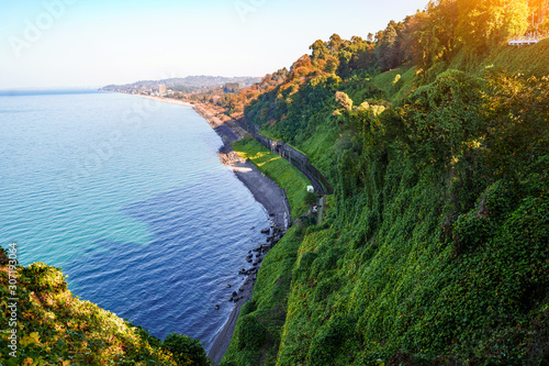 Beautiful, bewitching view of the blue sea, green cape and the railway from the Canvas Print