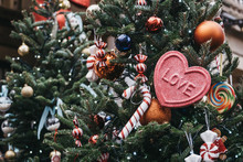 """Christmas Tree Full Of Traditional Christmas Baubles, Decorations And A Pink """"LOVE"""" Heart."""