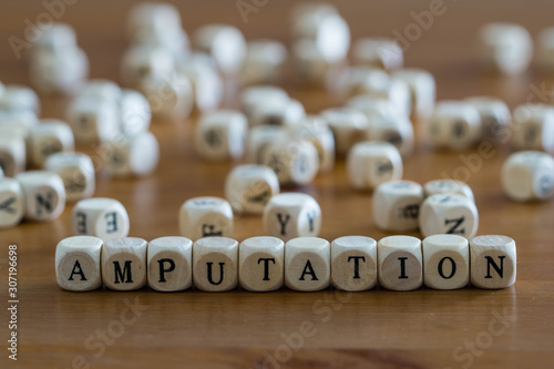 Amputation written with wooden cubes Canvas Print