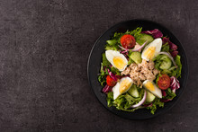 Salad With Tuna, Egg And Vegetables On Black Background Top View Copy Space