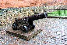 Riga, Latvia, November 2019. An Old Cannon Near The Fortress Wall In The Historical Part Of The City.