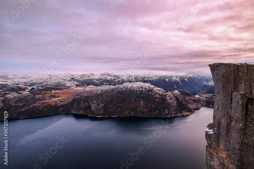 Fototapeta The famous Preikestolen Pulpit Rock over the Lysefjord, beautiful colors at sunset, Ryfylke, Rogaland, Norway obraz na płótnie