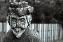 Creepy Wooden Old Woman. Wooden Figure Of An Old Smiling Witch