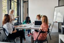 Businesswomen Having A Meeting...