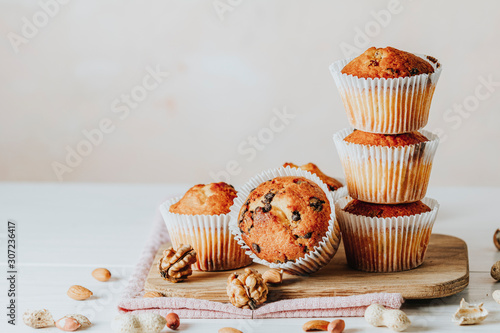 Wallpaper Mural Vanilla caramel muffins in paper cups on white wooden background