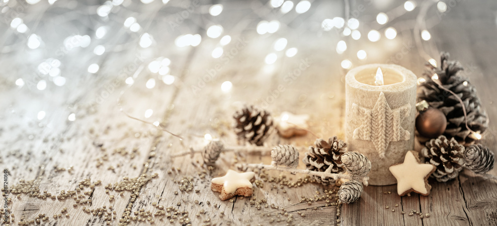 Fototapeta White Christmas candle on rustic wooden boards -  Decoration with natural elements, twigs, pine cones and cookies  -  Advent banner, panorama with magic bokeh lihgts