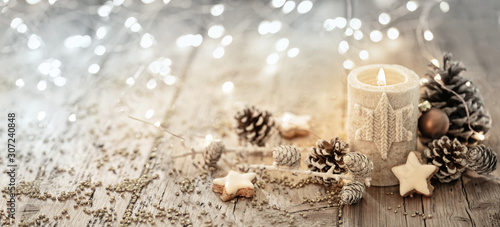 White Christmas candle on rustic wooden boards -  Decoration with natural elements, twigs, pine cones and cookies  -  Advent banner, panorama with magic bokeh lihgts - 307240848
