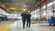 Two executive partners in formal suits walking through plant facility and discussing collaboration
