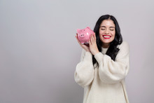 Young Woman With A Piggy Bank ...