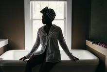 Woman Relaxes By Bathtub Weari...