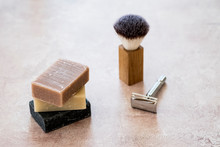 High Angle Close Up Of Three Bars Of Homemade Bars Of Soap, Shaving Brush And Razor.