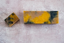 High Angle Close Up Of Yellow And Black Homemade Bar Of Soap.