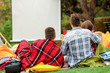 Friends watching movie in outdoor cinema