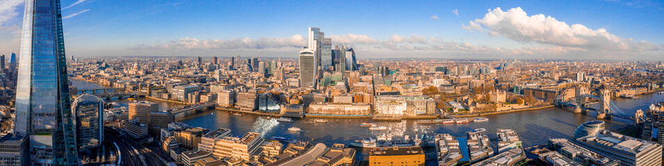 Stunning panorama view over Thames river, the Shard, the London skyline and cityscape from the skyscraper. Aerial photo over the big city.